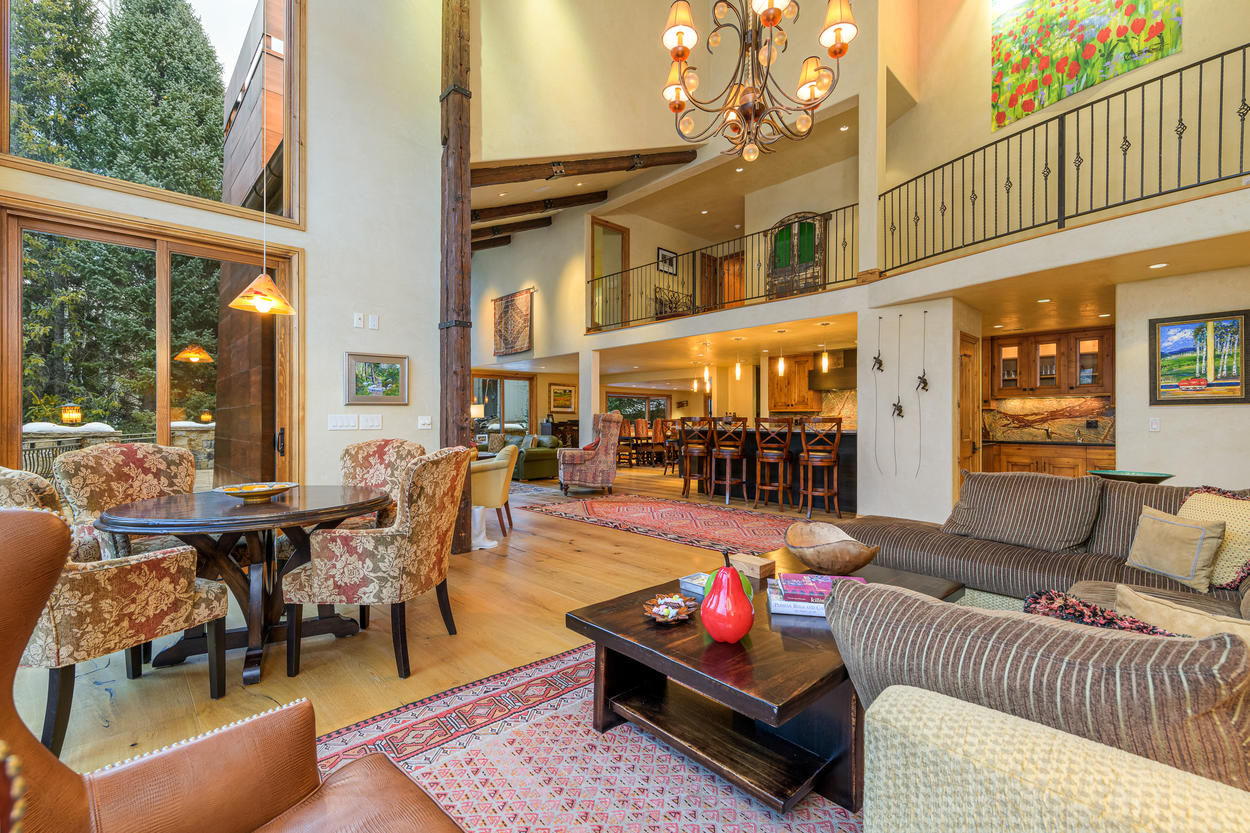 The living area opens up into a room with vaulted ceilings and excellent mountain views.