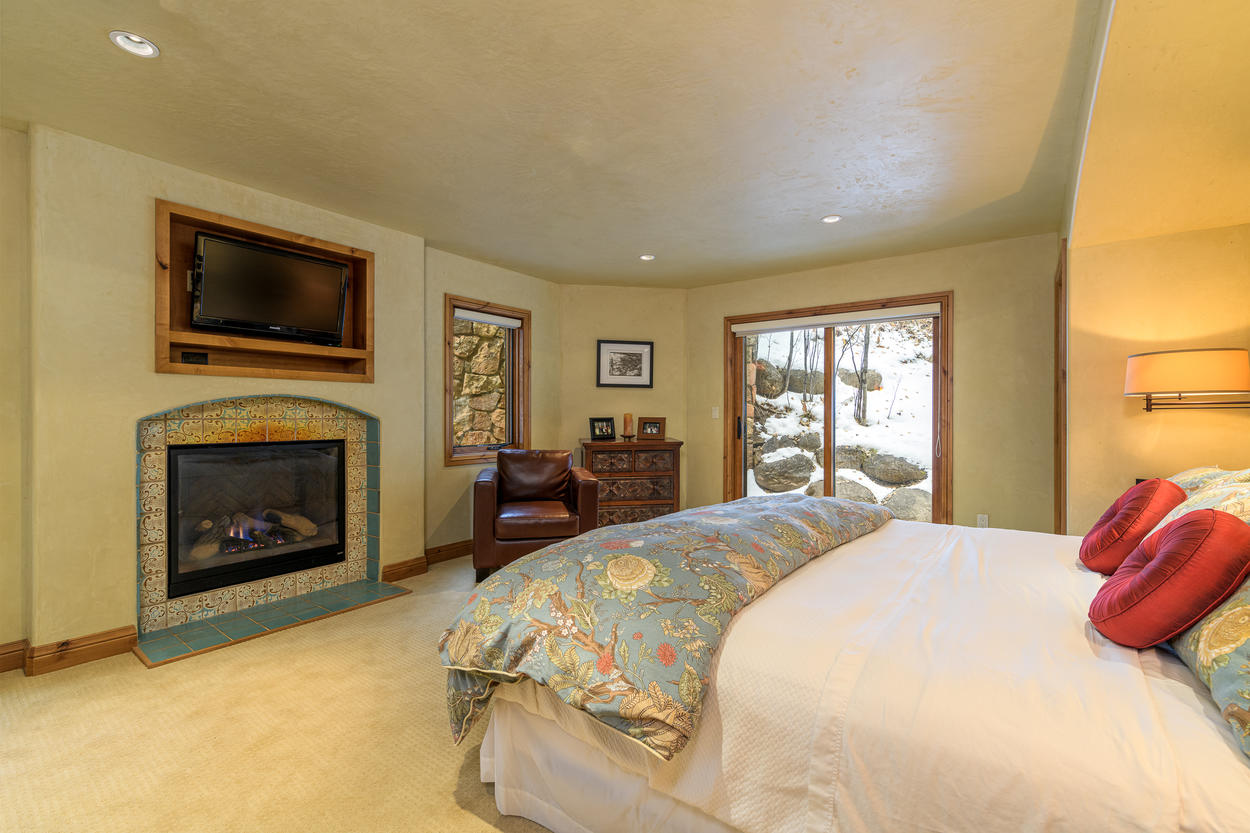 The second King Bedroom, also located on the second floor, has a gas fireplace and built-in TV.