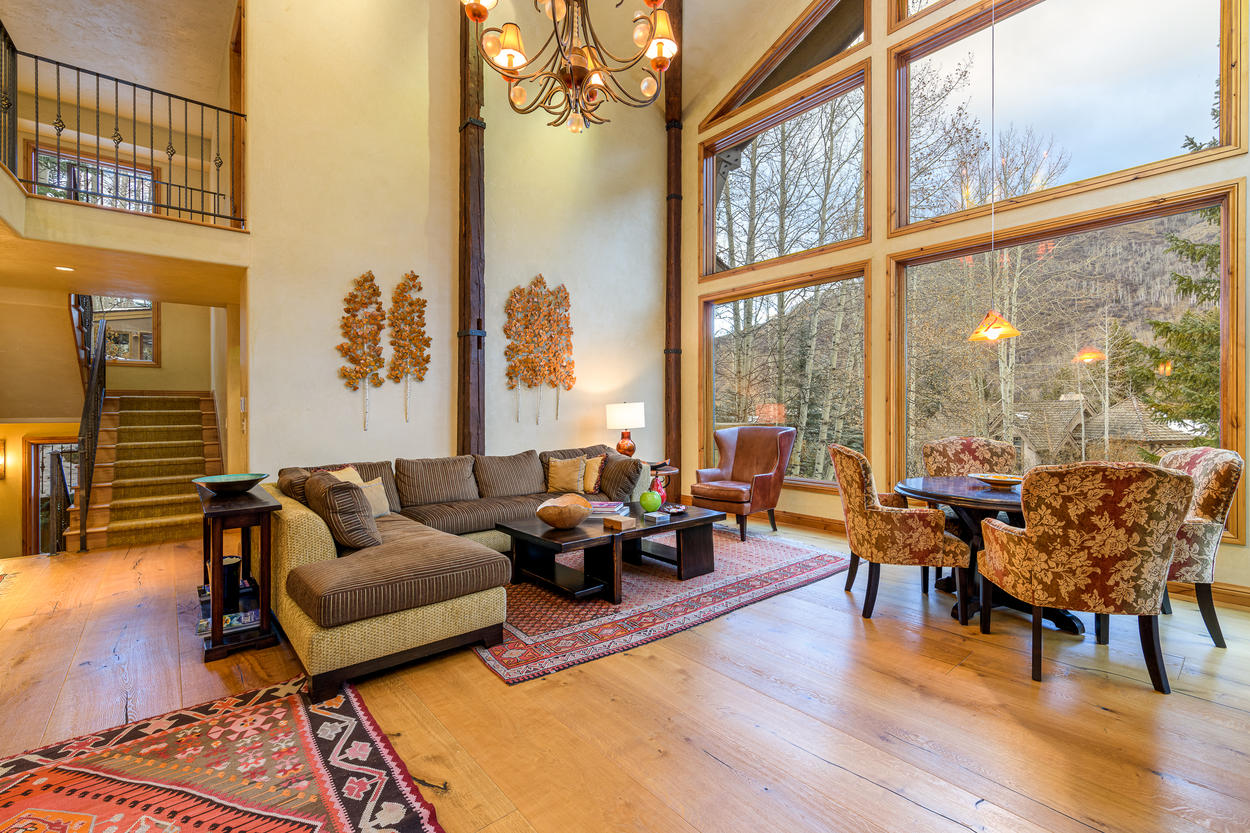 The main living area has tall, vaulted ceilings that open up to the walkways of the third floor.