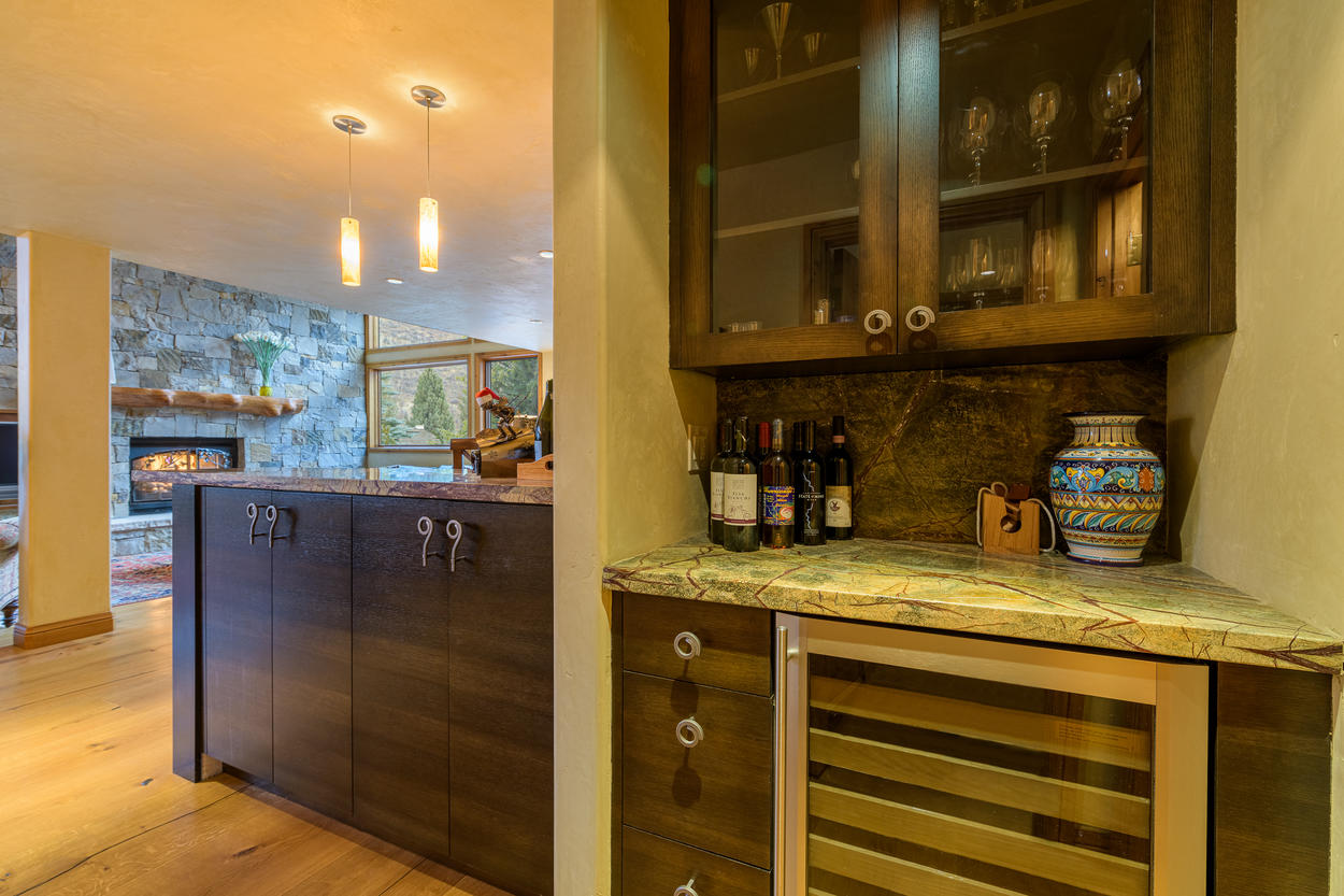 The wine fridge is conveniently located just across from the dining area.