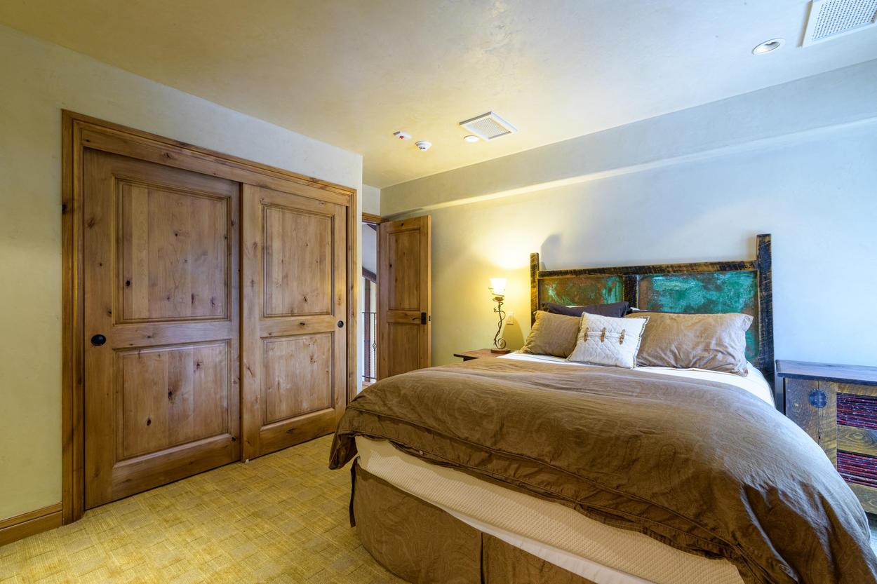 The Queen Guest Bedroom is located on the top floor.