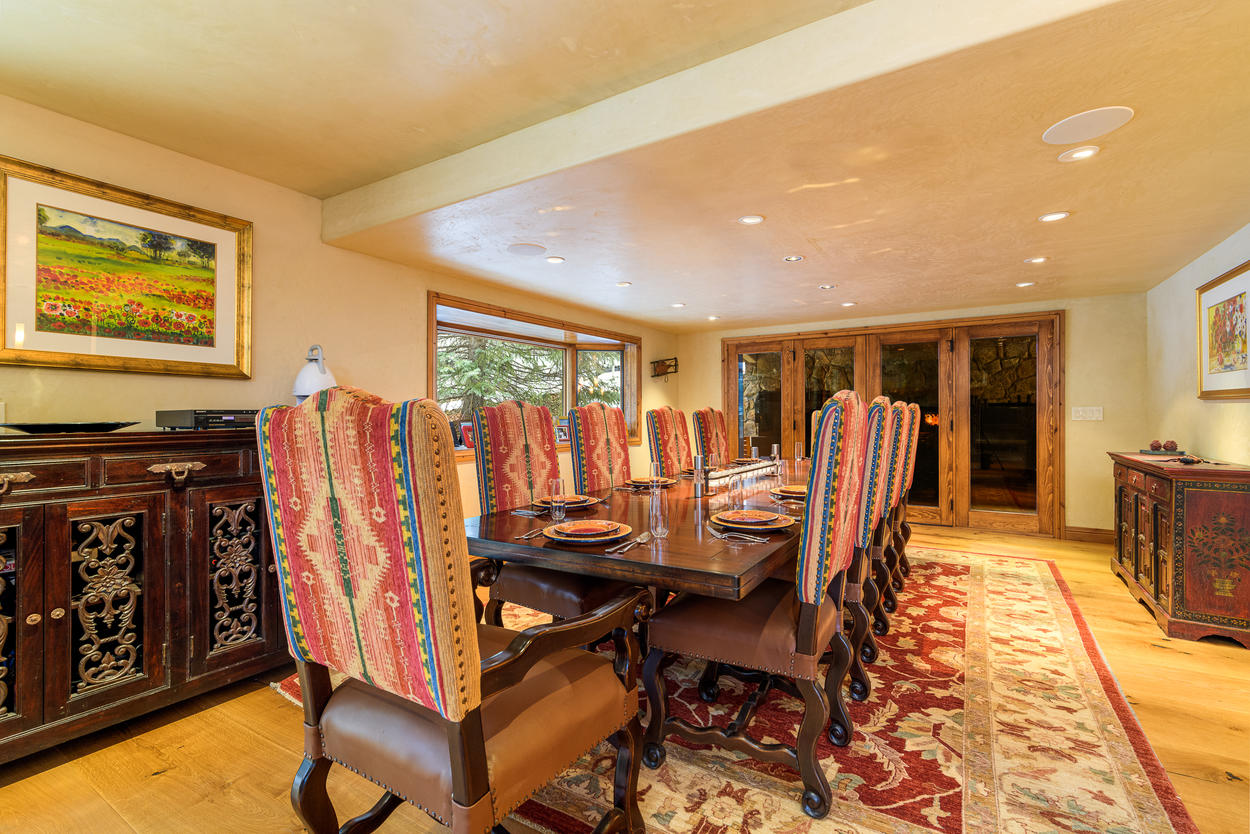 The dining area is located just off from the kitchen and features a large table with seating for 10.