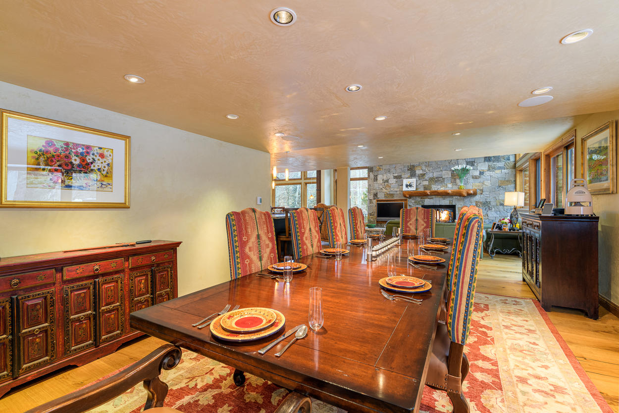 The dining area is just across from the far side of the main living room.