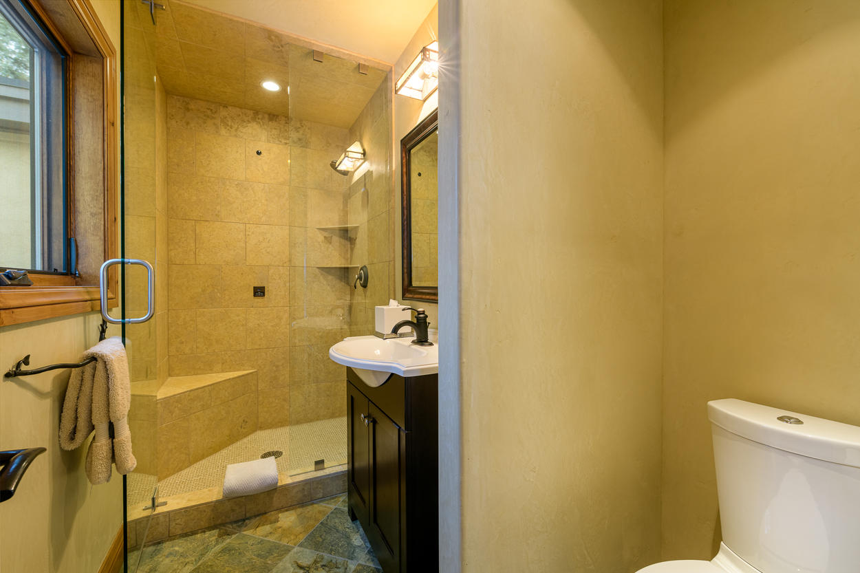 The ensuite bathroom for the third twin room includes a walk-in shower and single vanity.