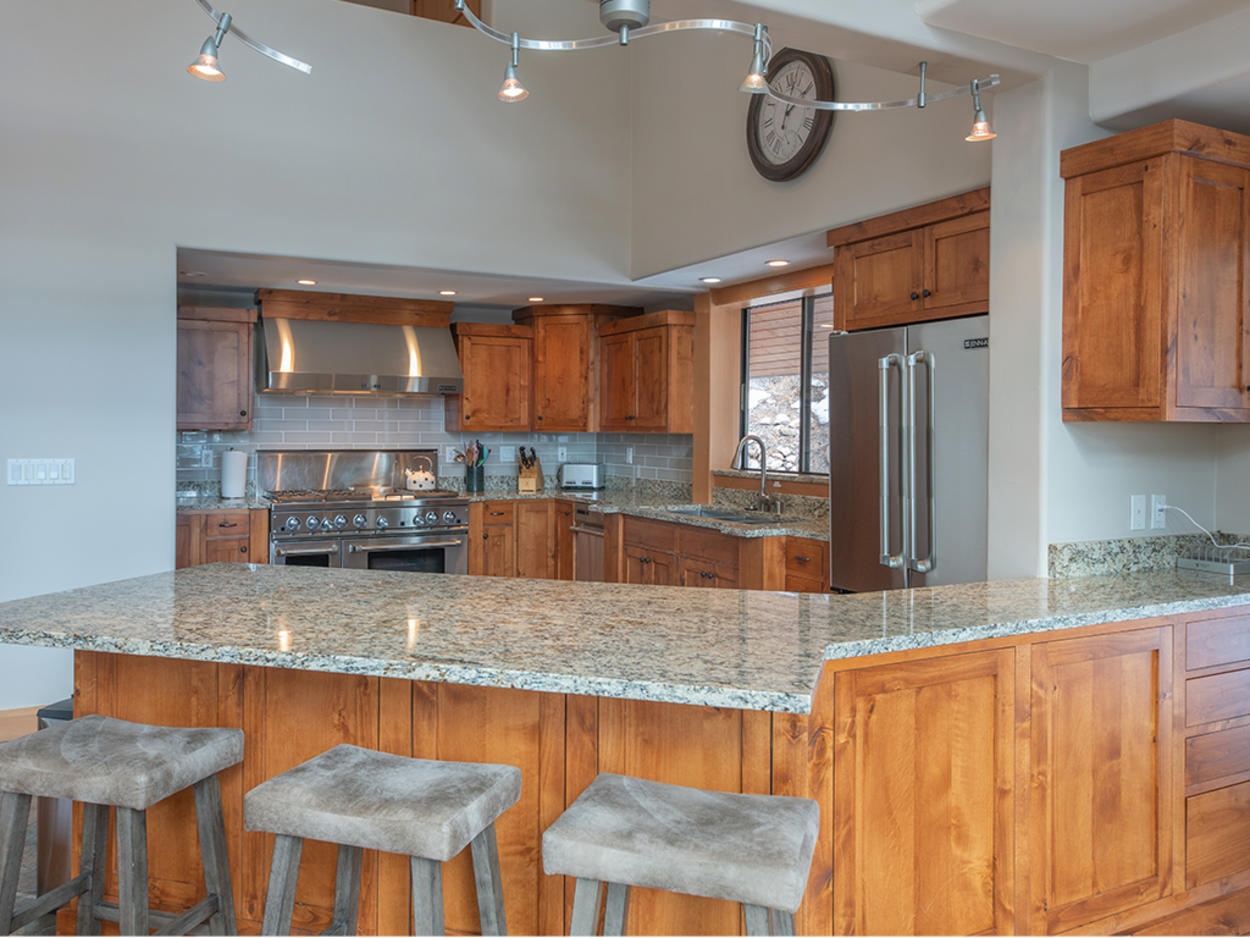 Enjoy the fully equipped kitchen with modern appliances and extra bar seating.