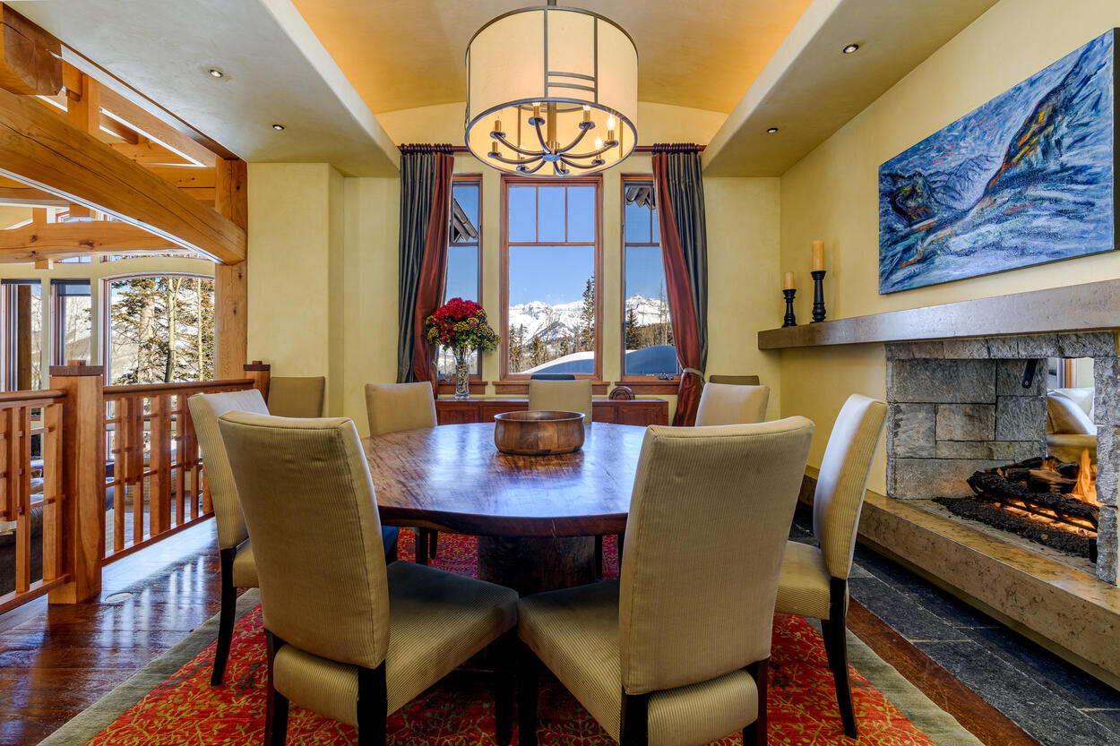 Enjoy meals near the fireplace at the dining table