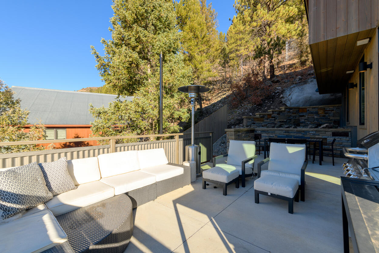 Sip a glass of wine outdoors, while waiting for the bbq on the spacious outdoor patio
