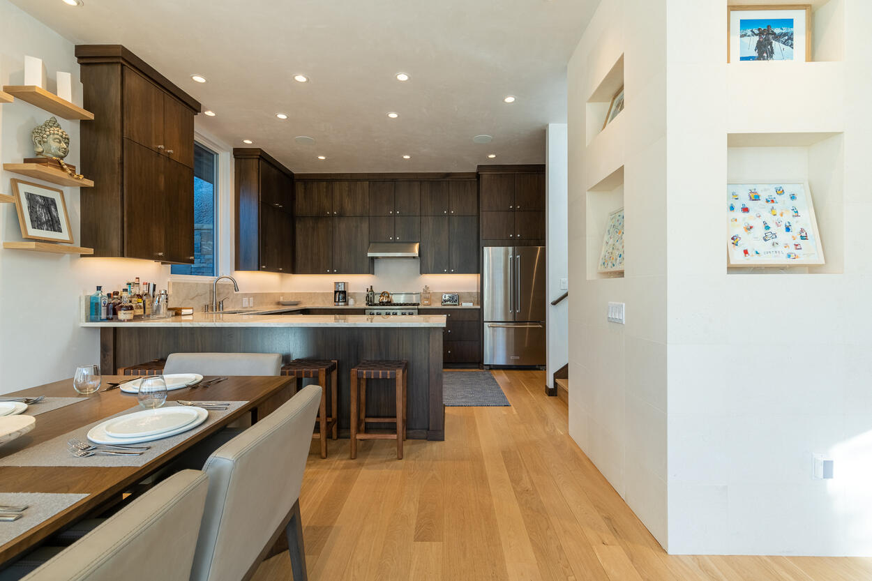 Perfect balance of warmth from the dark wood cabinets and cool stainless steel appliances, any meal from the kitchen will be served perfectly to the dining table