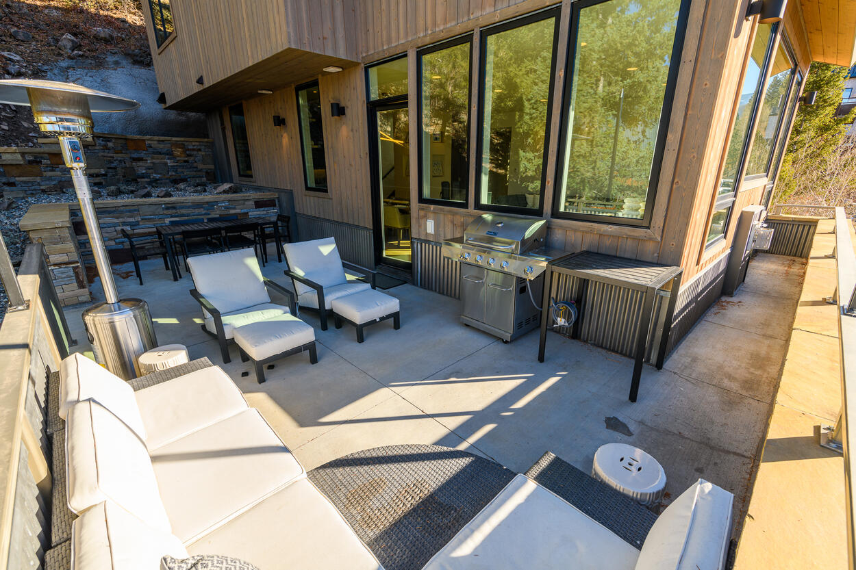 Lounge on the couches or savor a meal around the outdoor dining table, with easy access to the kitchen and indoor dining