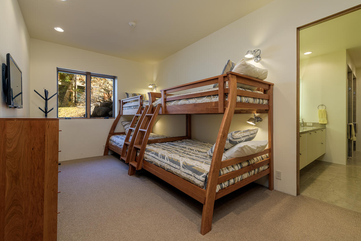 Double bunk room with full on the bottom and twin on top downstairs
