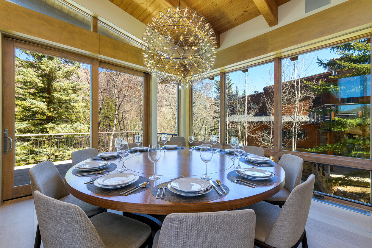 Large dining table with a lazy susan center, and stunning views